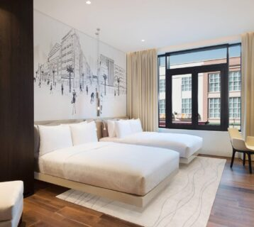 The chic designed twin room at La Ville Hotel